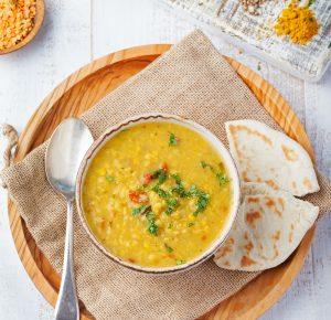 lentil-soup-with-bread-in-a-ceramic-white-bowl-P725QYZ